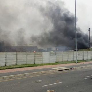 Protesters-have-now-set-the-local-recycling-centre-alight-in-Mbeki-Rd.-This-des  Protesters have now set the local recycling centre alight in Mbeki Rd. This, des… Protesters have now set the local recycling centre alight in Mbeki Rd