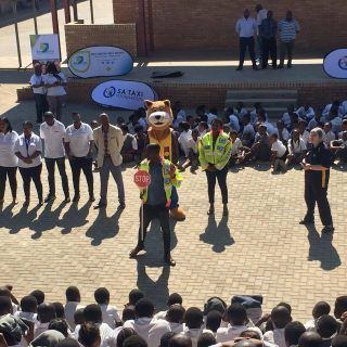 """#RoadSafety mascot """"DannyCat"""" conducting edutainment at the Cosmo City primary s… 43677261 1898812366867545 7363462910615486464 o 320x320"""